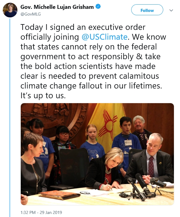Governor of New Mexico signing executive order joining @USClimate