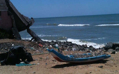 A wrecked house and fishing boat and debris-strewn beach are legacies of the tsunami's impact on the village of Sulerikattukuppam in Tamil Nadu.