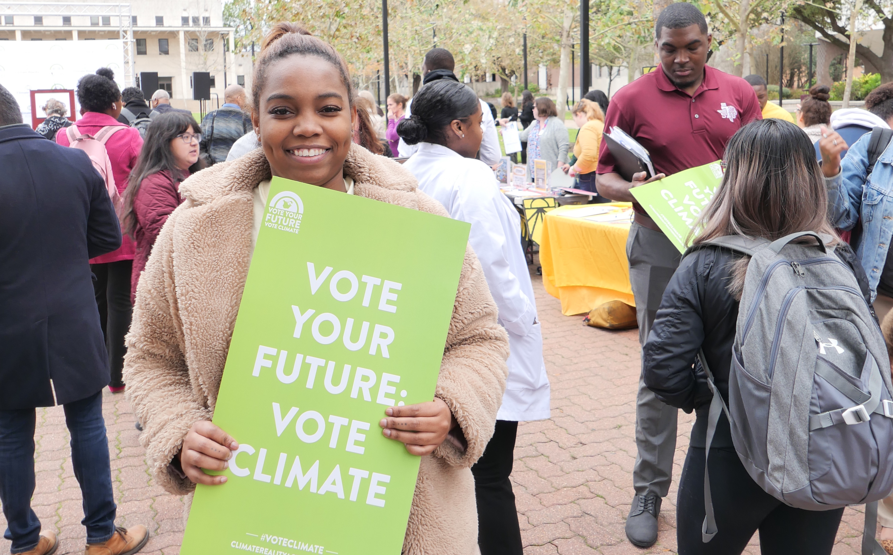 TSU student with vote your future sign